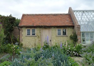 Potting shed attached to greenhouse.
