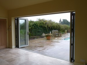 Bi-fold doors opening onto the pool area