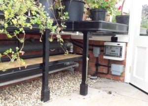 HH2 Controller positioned under the greenhouse bench, controls both the heat and vents.