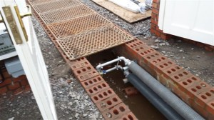 Heating Pipes installed in a floor duct.